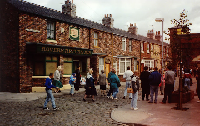 Image: Tourists get to see round the set of the long-running TV drama Coronation Street, by Allan Lee on Flickr
