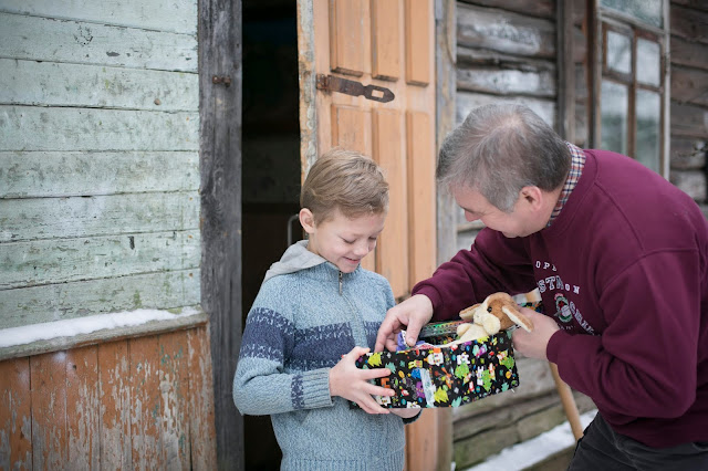 Boy in Belarus receiving his Operation Christmas Child shoebox