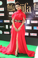 Apoorva in a Stunning Tight Leg Split Sleeveless Red Gown at IIFA Utsavam Awards 10.JPG