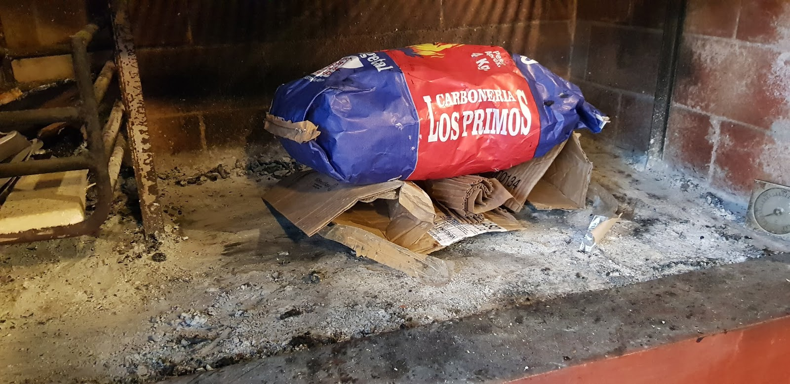 Parrilla with carton fire