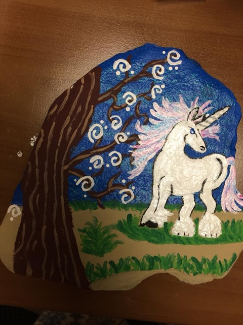 unicorn by a tree painted rock