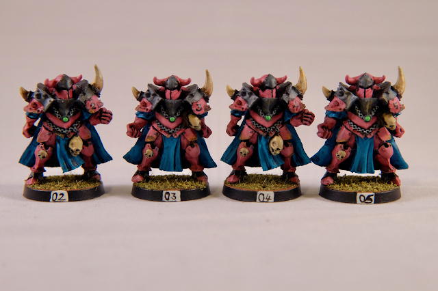 Four Chaos warriors in Pink and Turquoise