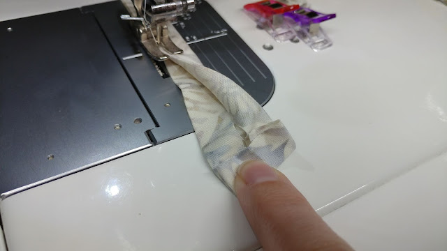 Sewing straps on homemade face mask