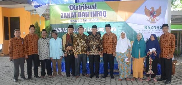 Plt Bupati Lampura Hadiri Acara Distribusi Zakat dan Infaq Tahap III Tahun 2019