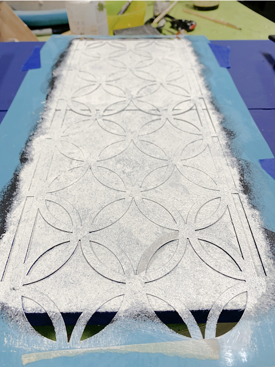 white lacy stencil design