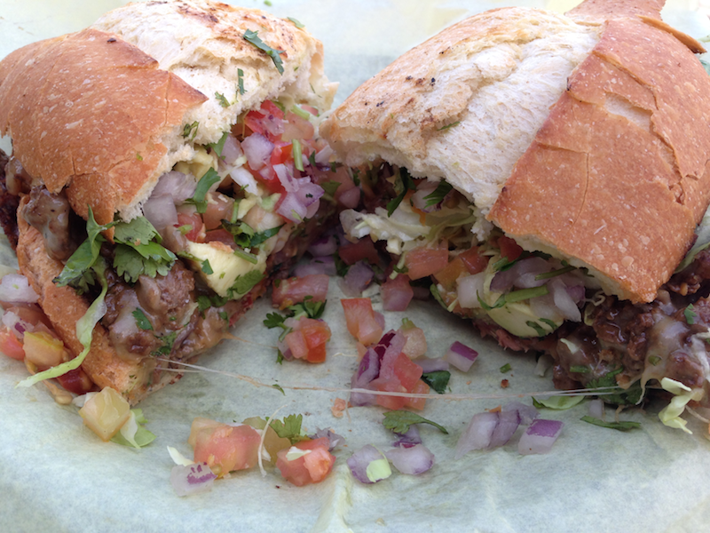 Torta de Oscar with spicy shrimp, smoked fish, and skirt steak