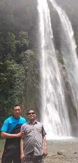 Photo of me with my colleague Ugyen Wangchuk at Panbang twin waterfalls. Photo taken on the way from Zhemgang to Samdrup Jongkhar