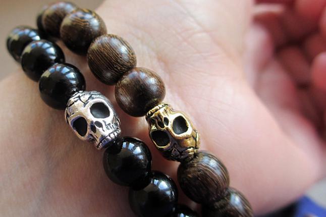 Two Binchohan Skull Beaded Bracelets on a wrist