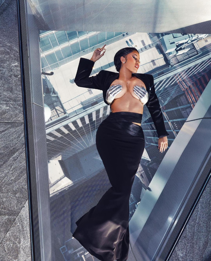 Photos as Card B show off her boobs on braless and topless for XXL magazine shoot