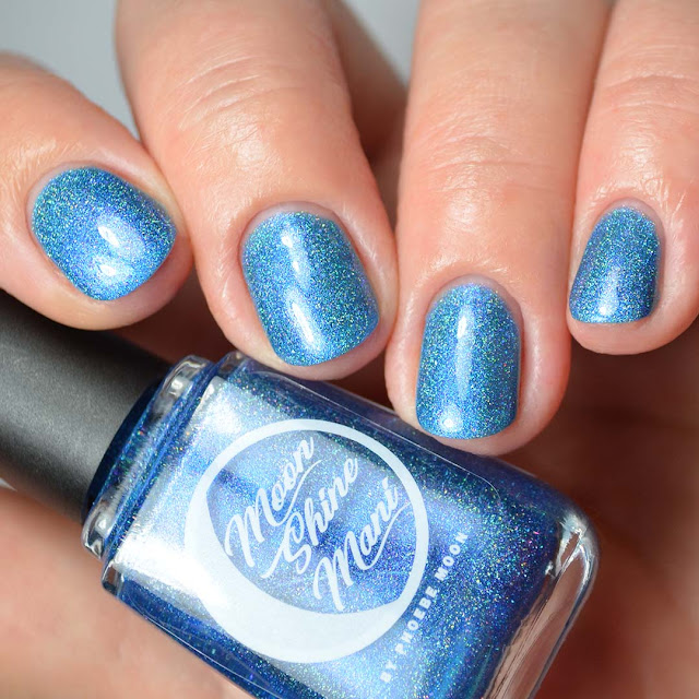 blue nail polish with shimmer swatch