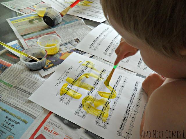 Preschool painting to music activity