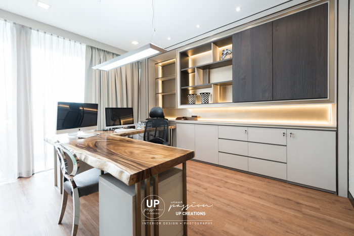u thant penthouse residence study room in elegant style with natural solid wood slab as work desk with custom made steel frame, custom made pedestal drawer and book shelf with combination of fabric, dark walnut, bronze texture and led strip light