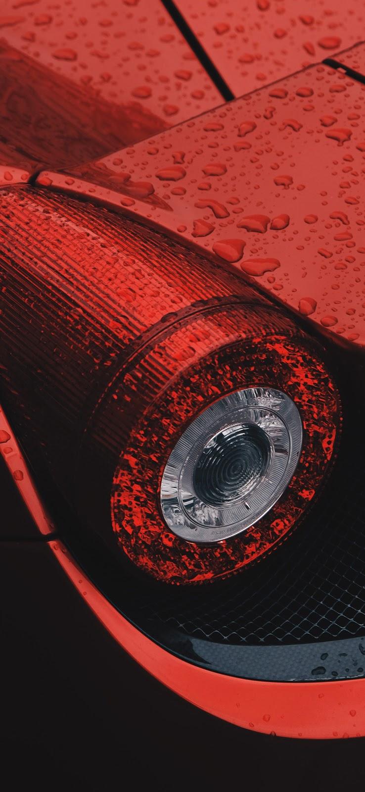 rain drops on red car tail light wallpaper