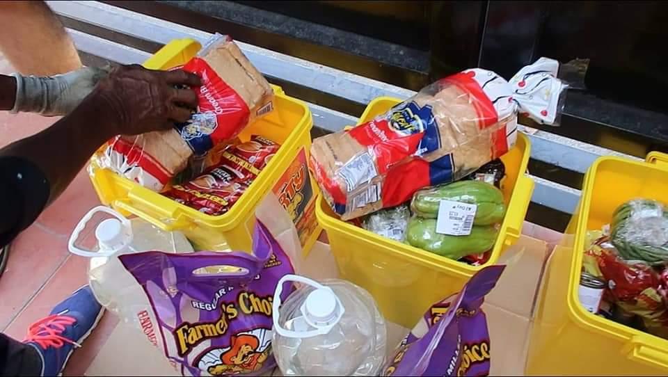 Trash bins full of groceries