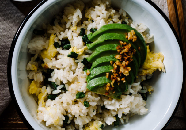 Simple fried garlic rice served with avocado