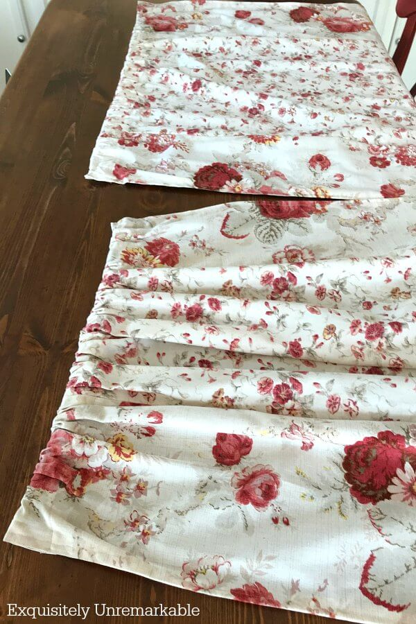 Waverly Red Roses fabric panels on a wooden table