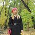 Dark blue cloak and a pink beret