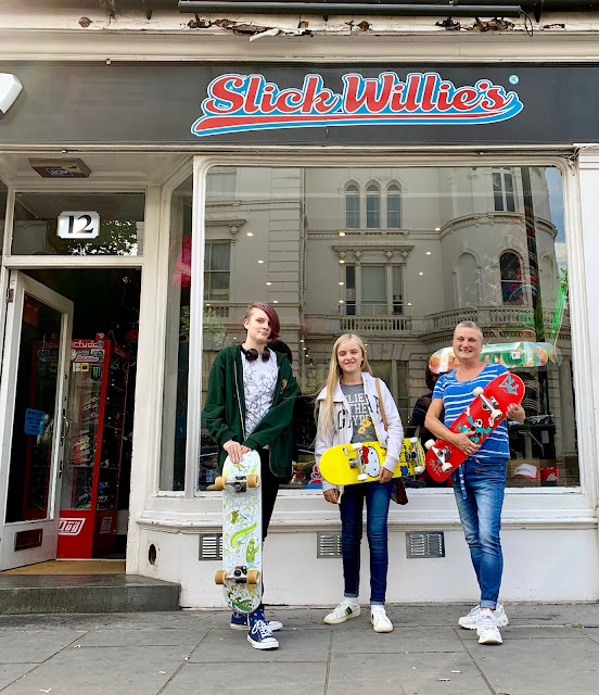 madmumof7 and daughters outside Slick Willie's skate shop, London