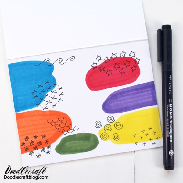 Then, use MONO Drawing Pen 03 to doodle little shapes and patterns around the colored shapes.