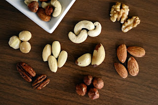 different mixed nuts placed on table