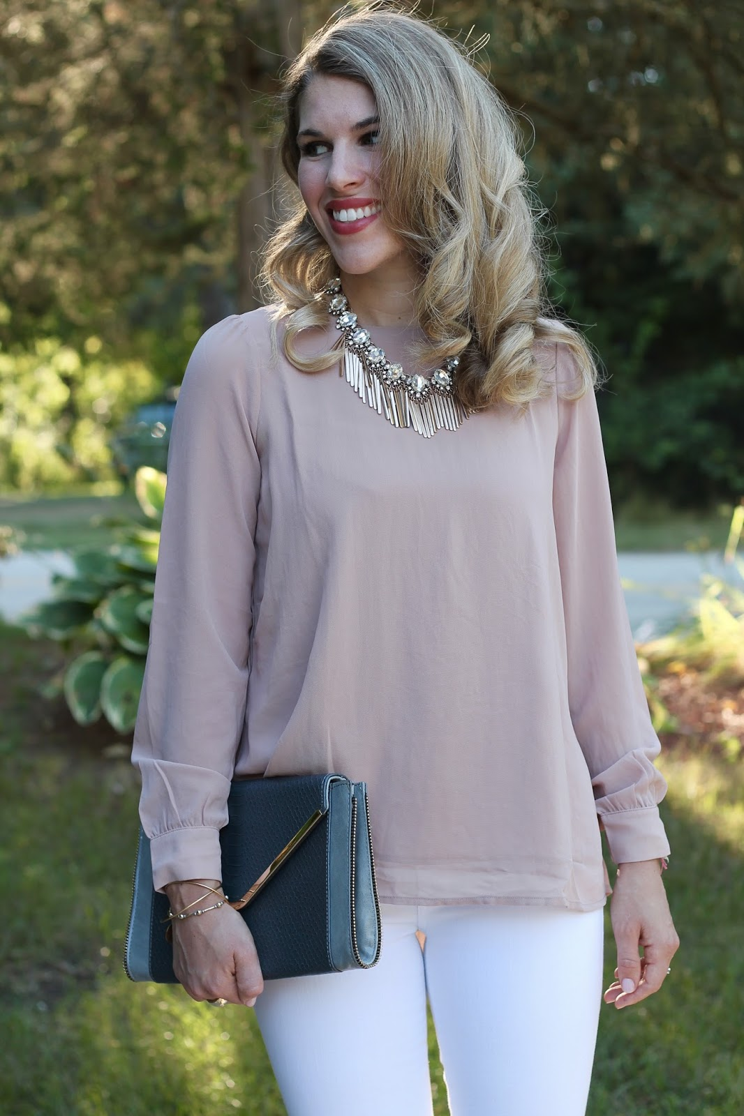 pleated back blush blouse, white jeans, lace up snakeskin heels, grey envelope clutch, statement necklace, date night look with white jeans, blush blouse and white jeans look