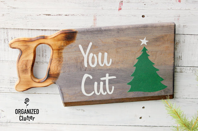 Photo of saw shaped cutting board repurposed as a Christmas tree farm sign