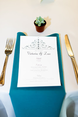 turquoise reception place setting with menu card