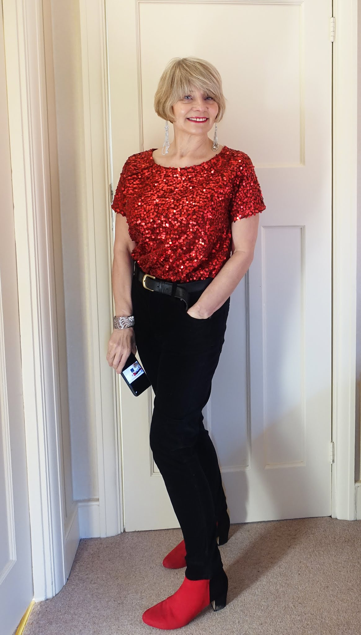 A red sequin top with jeans and red and black boots worn by Is This Mutton? blogger Gail Hanlon and proving that sequins are fine for day time
