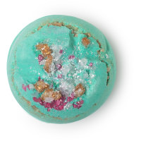 A green spherical bath bomb with engravings all over it and silver shimmer on a bright background