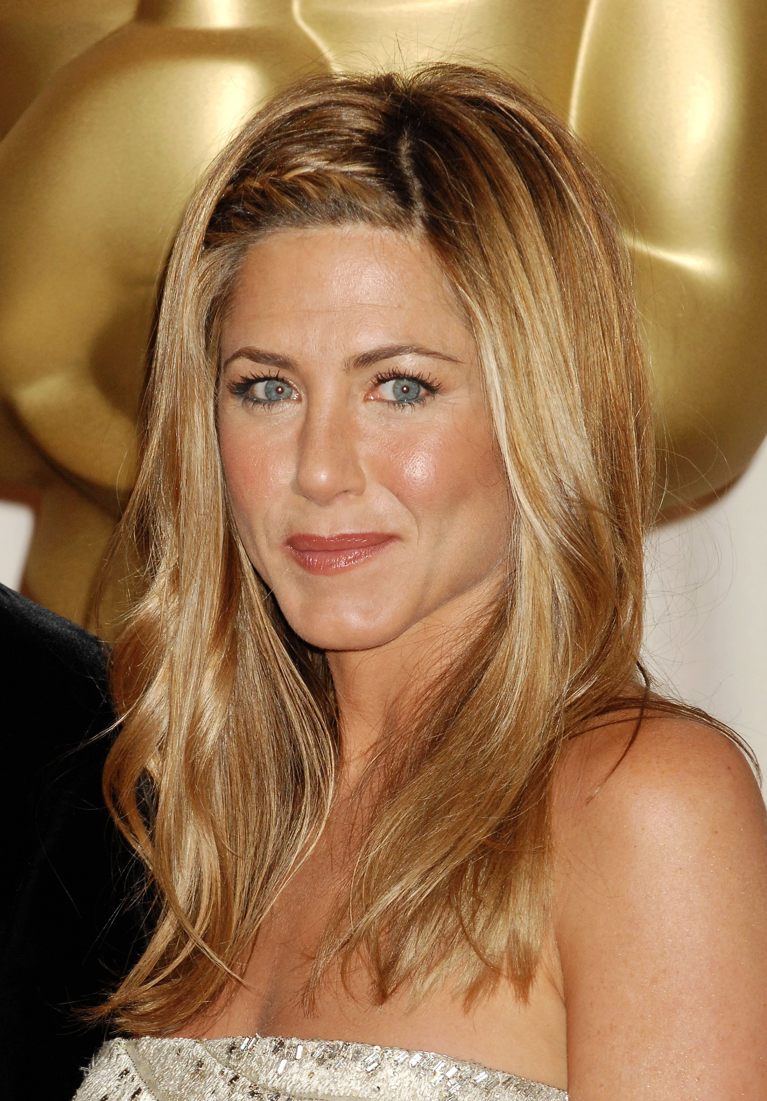Jennifer Aniston 50 poses topless while revealing she is