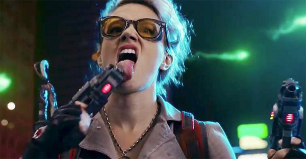 screen cap of Kate McKinnon in Ghostbusters, licking her ghostbustin' weapon
