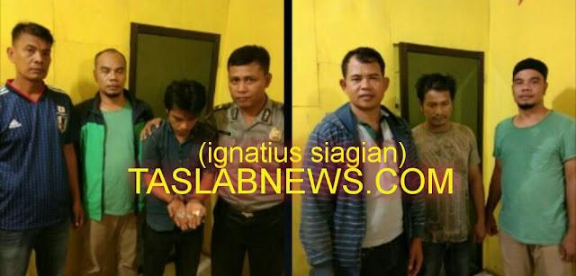 Kedua tersangka dan bRang buktinya saat diamankan di Polsek Tanjungbalai Selatan Resor Tanjungbalai,  Sabtu (8/9)
