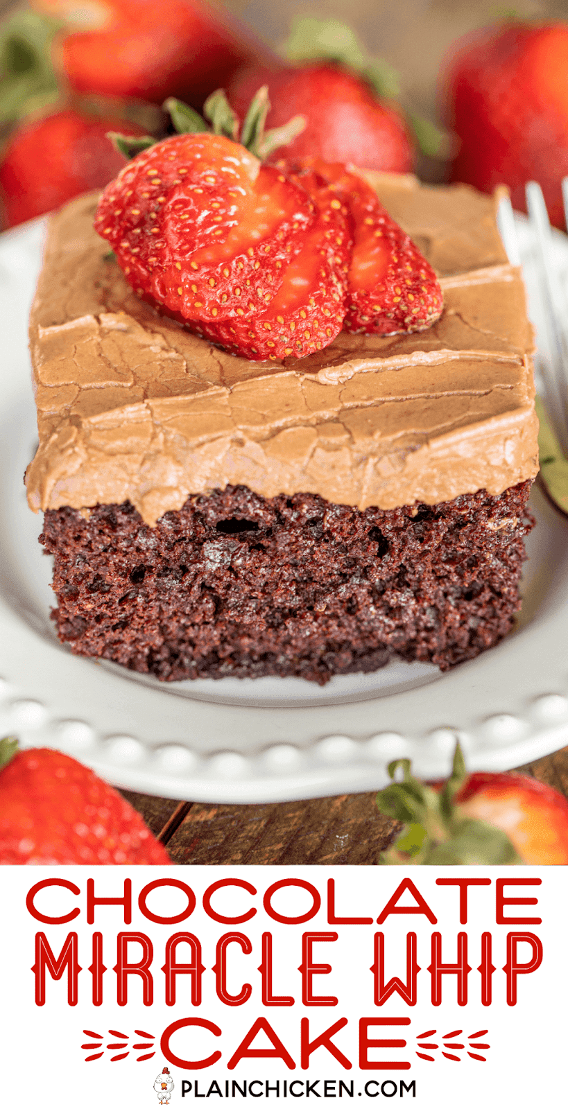 slice of chocolate cake topped with strawberries on a plate