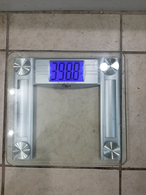 Scale showing 398.8 pounds US.
