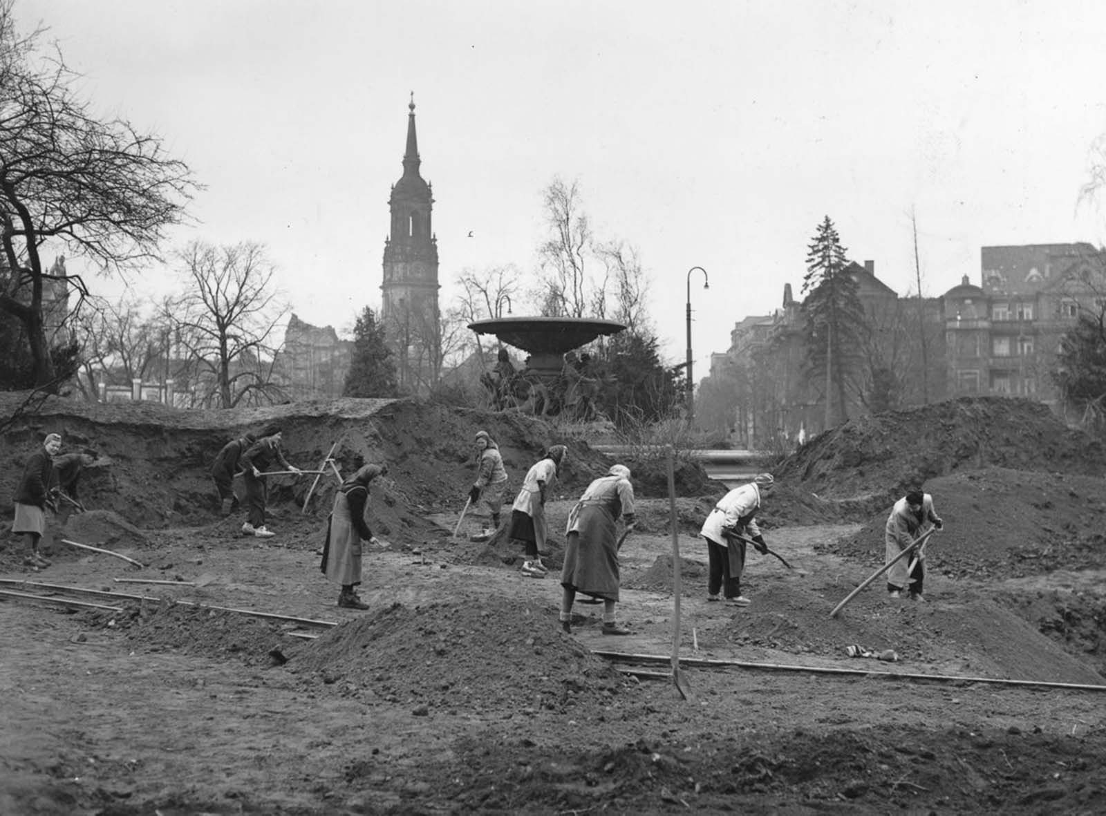 Volunteers spend a Sunday morning clearing rubble. 1946.