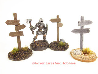 A 28mm scale knight stands amongst the signposts.