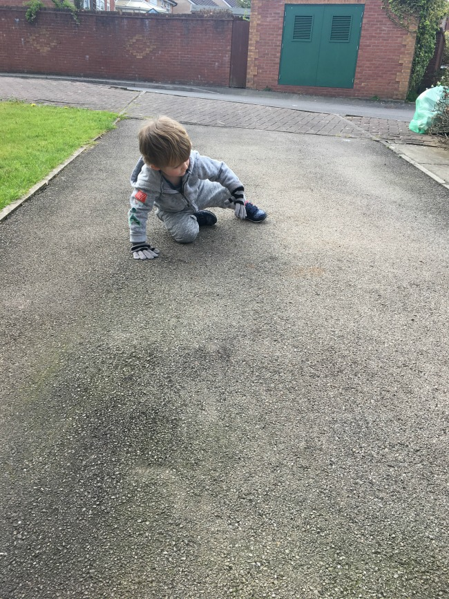 Our-Weekly-Journal-Grandad's-New-Hip-toddler-crouching-on-tarmac-drive