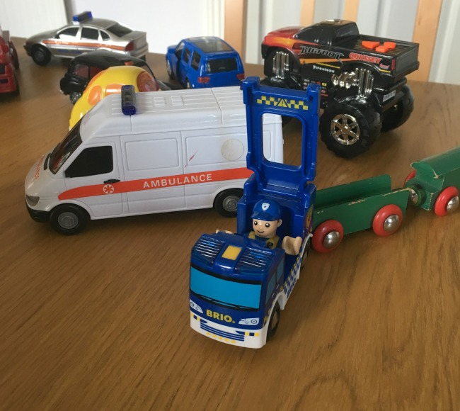 brio-police-car-with-policeman-figure-driving-with-other-emergency-vehicles-in-background