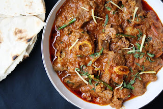 http://maunikagowardhan.co.uk/cook-in-a-curry/mughlai-karahi-gosht-slow-cooked-lamb-curry-with-tomatoes-garlic-and-garam-masala/