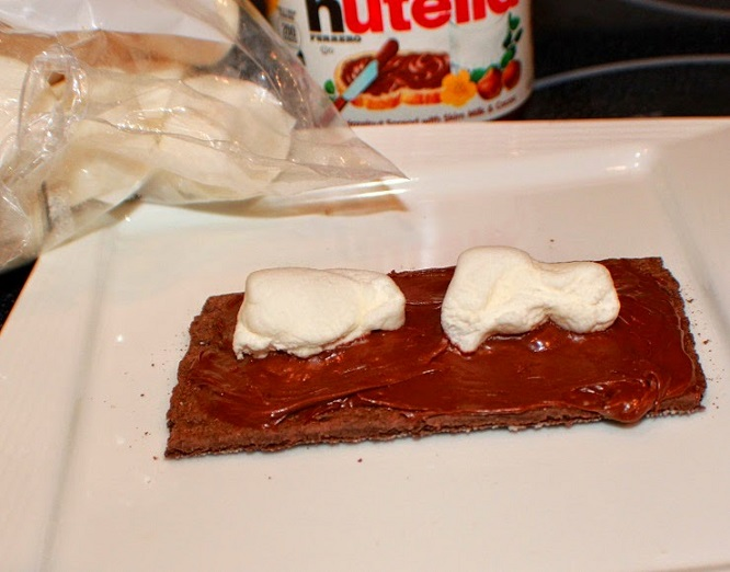 nutella, marshmallows on top of chocolate graham crackers