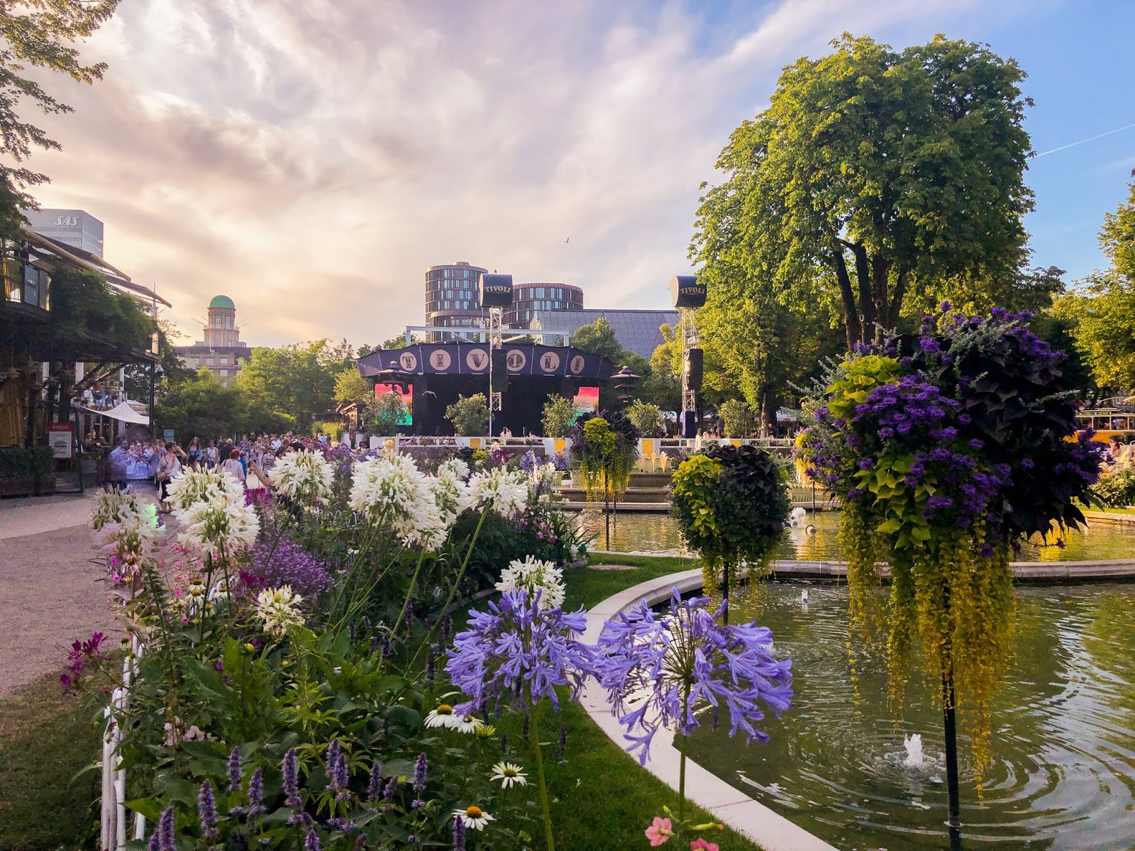 Copenhagen's Tivoli gardens main stage against pastel sunset sky and colourful flowers in the foreground