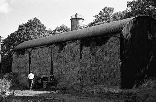 Photograph of the water tower at Brookmans just visible above the old A1 Dairy farm hay barn Image by Ron Kingdon taken in 1966, part of the Images of North Mymms Collection
