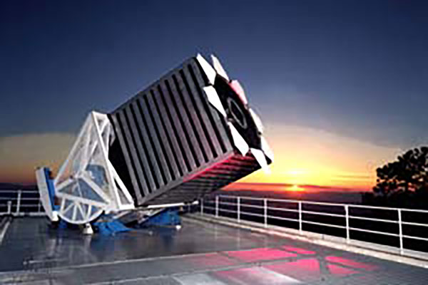 This is what the 2.5 meter Sloan Foundation Telescope looks like when operating (Source: www.apo.nmsu.edu)
