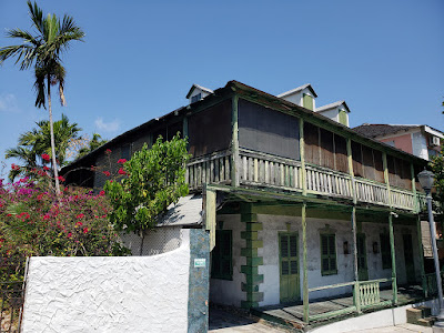 aged colonial style two storey house