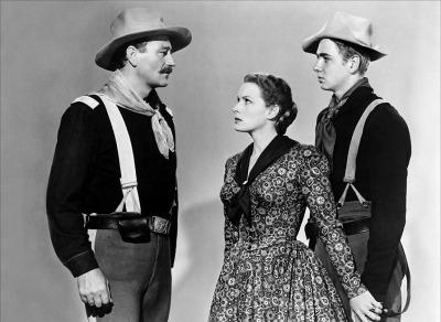 John Wayne, Maureen O'Hara, Claude Jarman, Jr. in scene from 1950's film Rio Grande