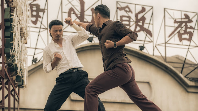 two men fight on a rooftop