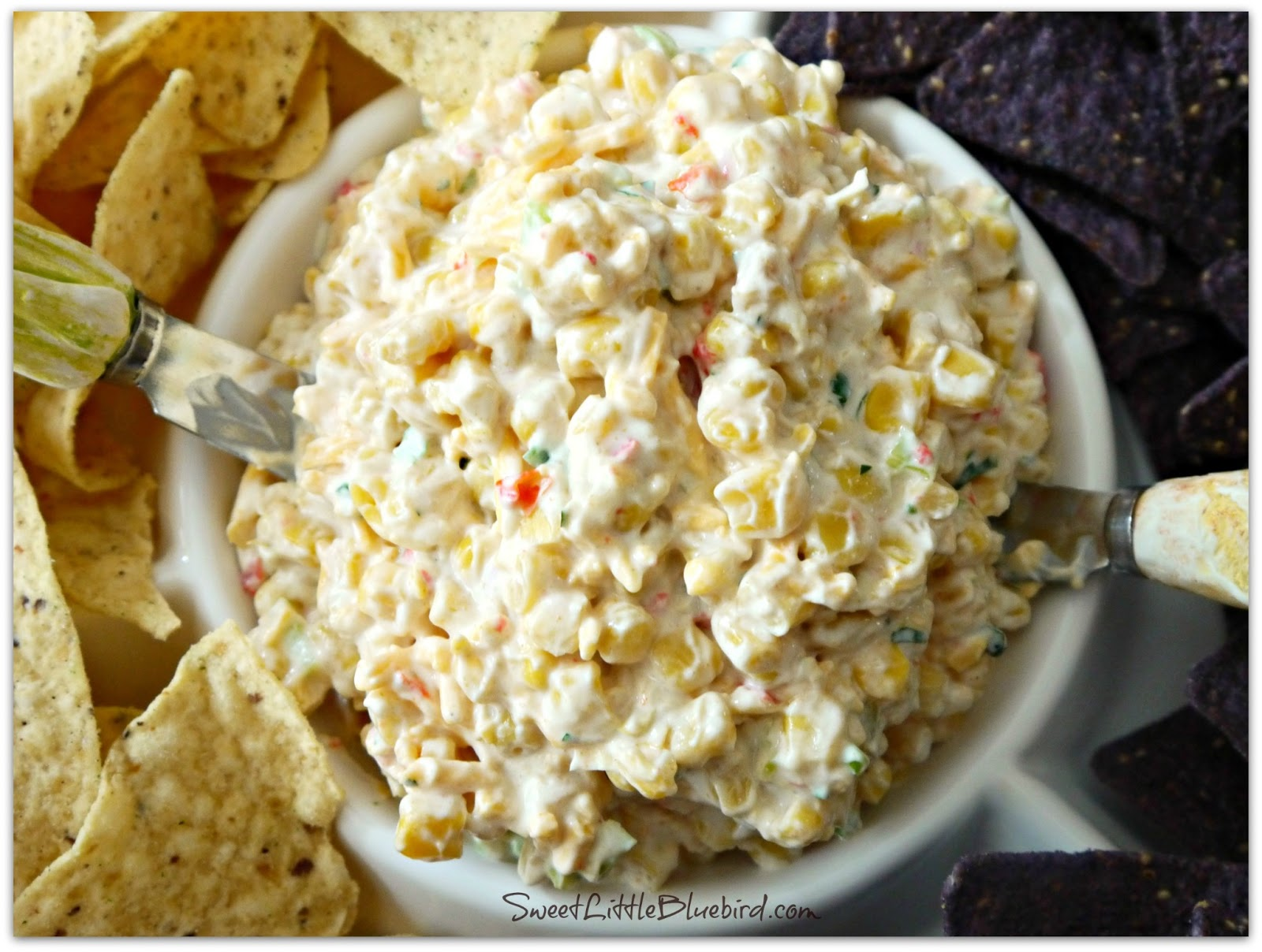 Fiesta Corn Salsa, is an appetizer that's always a hit and gets swarmed by guests. Be prepared to re-fill the bowl, this dip gets gobbled up fast!