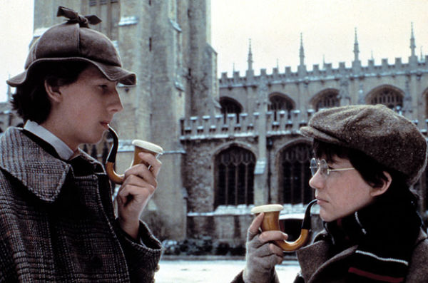 Nicholas Rowe and Alan Cox holding pipes in Young Sherlock Holmes
