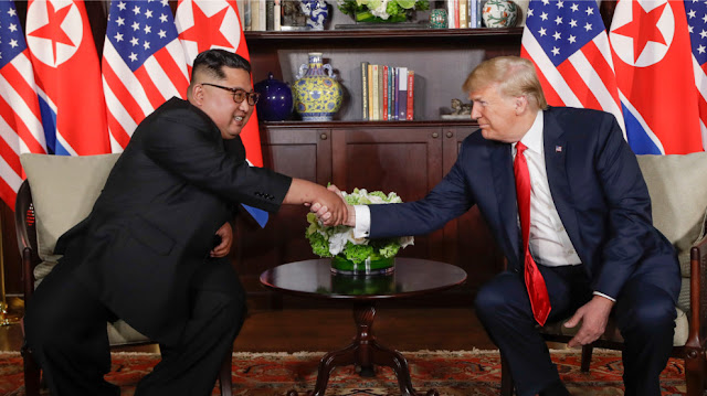 Donald Trump And Kim Jong-Un Finally Share Historic Handshake In Singapore (Photos)      Donald Trump has met Kim Jong-un, shaking the North Korean leader's hand and posing for the cameras at a historic summit in Singapore, The Independent reports.   Mr Trump arrived at the Capella hotel on Sentosa island looking slightly pensive, fiddling with his jacket buttons; Mr Kim appeared relaxed.   The pair greeted each other at a luxury hotel on the island, just off the Singaporean coast, before heading in for talks about denuclearisation.   It is the first time sitting leaders from both countries have ever met and marks a remarkable turnaround in the men's personal relationship.