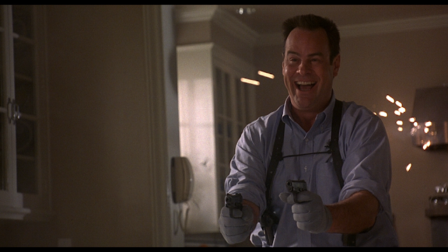 Dan Aykroyd shoots two guns